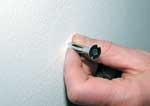"""Skoene har fått eget """"hus"""", så nå blir det ingen hauger av sko lenger."""