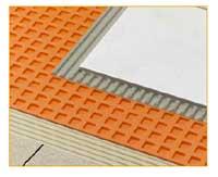 Flisene limes mot matten som først er limet til underlaget.