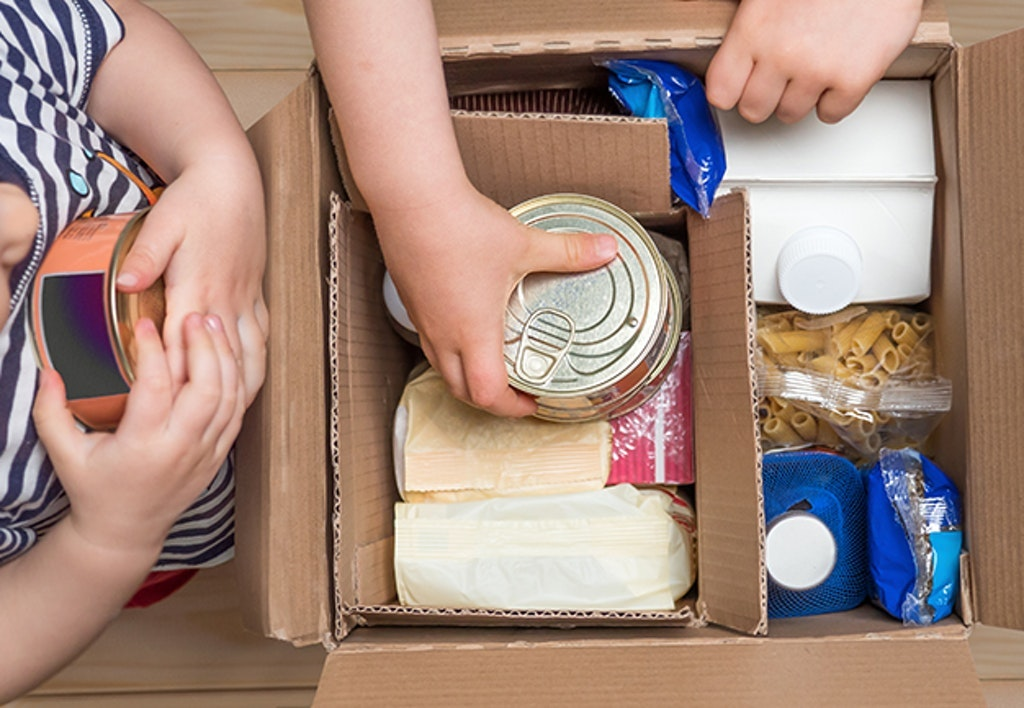 Children Opening A Food Delivery Box At Home, Online Ordering. Grocery Store Delivery. Box Full Of Food In Concept Donation Boxparcel. Delivery During Quarantine Due To Coronavirus Covid 19 Disease